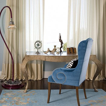 Classy-room-with-unique-metal-floor-lamp-and-marmer-table-also-blue-arm-chair-with-carpet