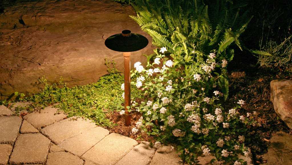 Create a beautiful atmosphere around your home with landscape path lights lining the steps to